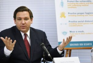 Florida Gov. Ron DeSantis addresses a panel during a roundtable discussion in Jacksonville.