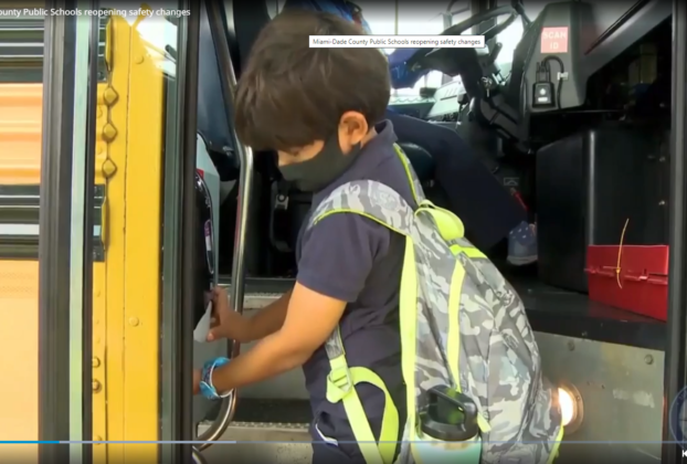school bus with hand sanitizer