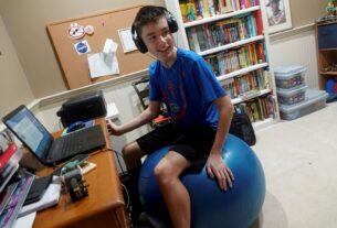 Andrew Burstein, 13, participates in a virtual class through Don Estridge High Tech Middle School in Delray Beach, Fla., this school year.
