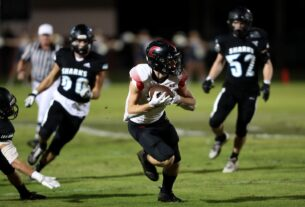 Creekside receiver Jack Goodrich, center, makes a catch and run in the first quarter during a Week 10 game at Ponte Vedra. (Ralph D. Priddy) (News4Jax)